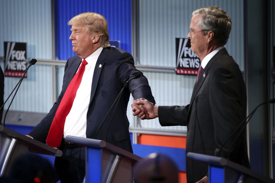 Donald Trump and former Florida governor Jeb Bush clasped hands during a debate in August 2015.