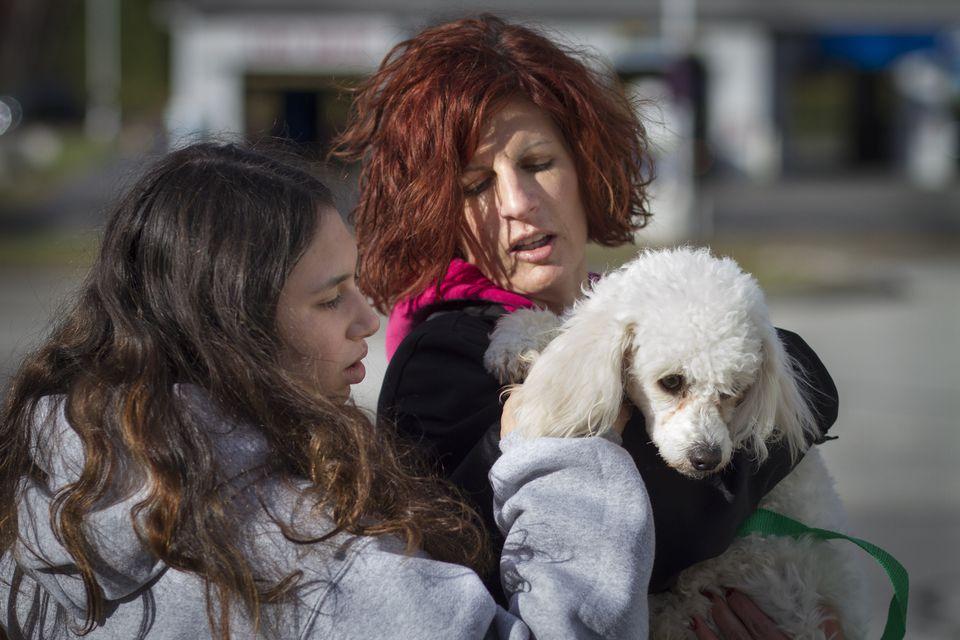 Gavi Azoff and her mom, Nicki, embrace their new pet.