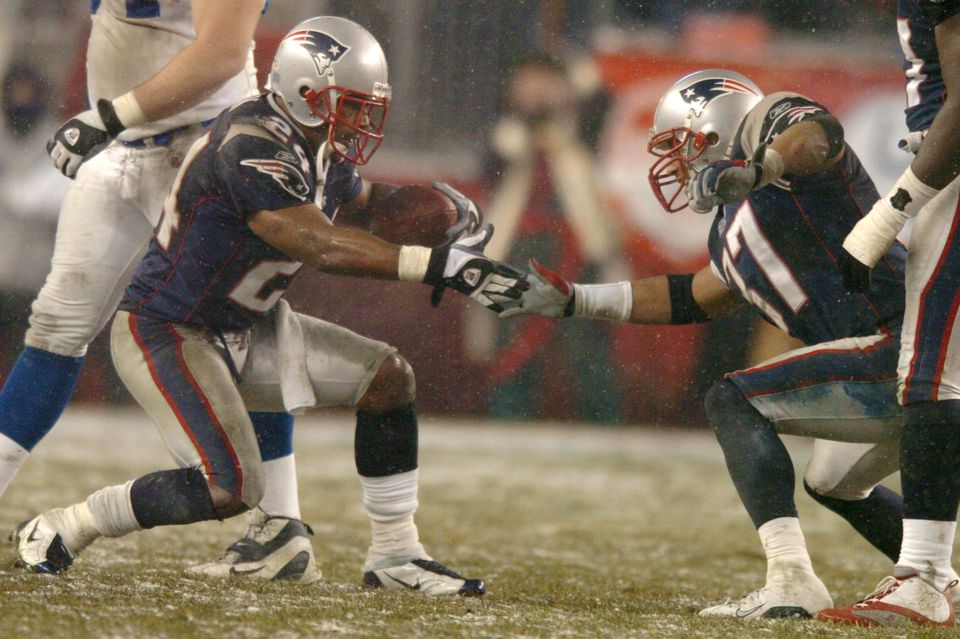 Ty Law (left) celebrates with Rodney Harrison after intercepting Peyton Manning for the third time in the 2003 AFC title game.