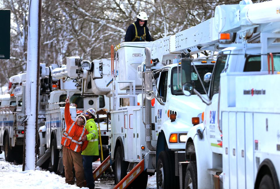 Electric utility trucks from New York worked on power lines on Main Street in Orleans on Wednesday.
