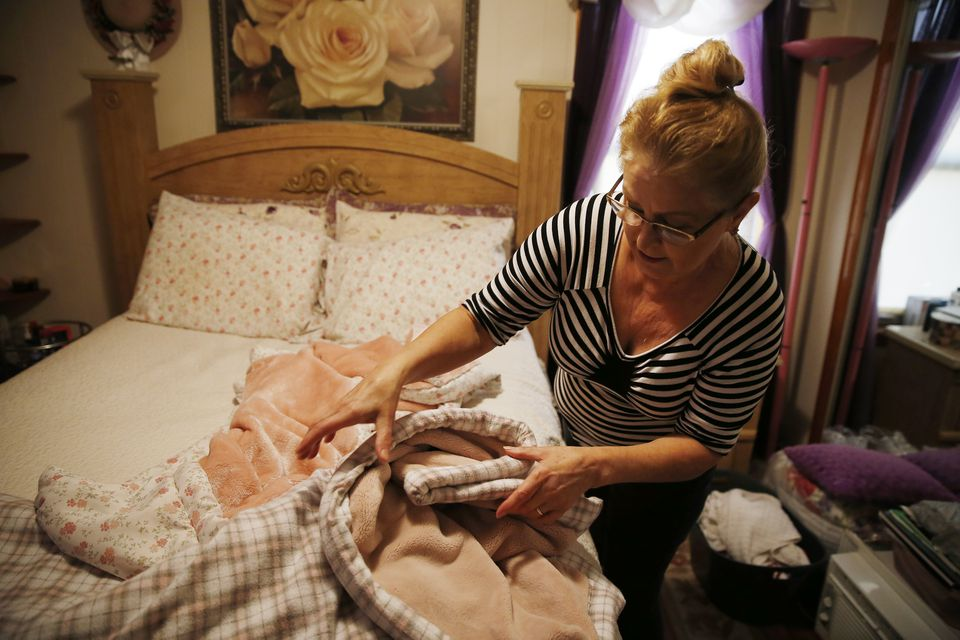 Cleonice Fazzolari, 62, has been sewing her own blankets to keep warm at her apartment in South Lawrence.