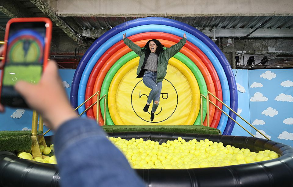 "Danae Pieroni gets a photo of herself jumping into a ball pit at ""Happy Place"" in Boston."