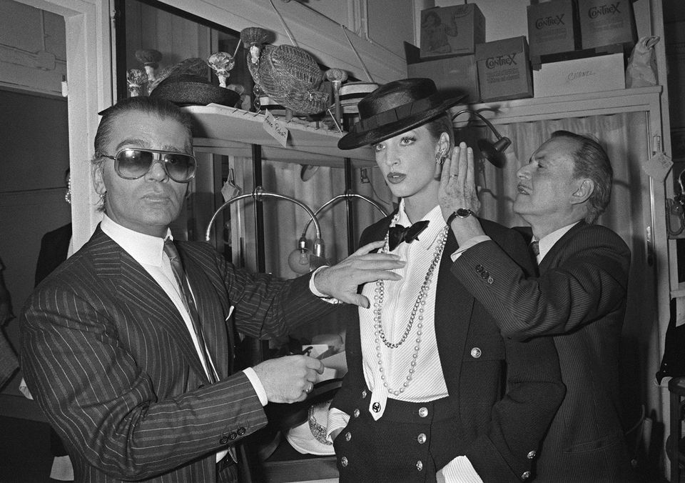 Mr. Lagerfeld (left) and hairstylist Alexandre adjusted a model's outfit during his first Chanel's Spring-Summer collection.
