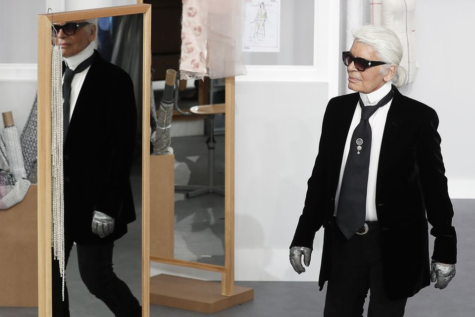 Mr. Lagerfeld's accomplished designs as well as trademark white ponytail, high starched collars, and dark enigmatic glasses dominated high fashion for the last 50 years.