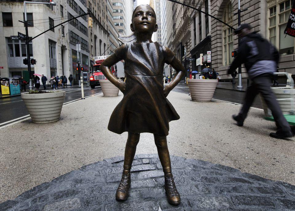 """The """"The Fearless Girl"""" sculpture by artist Kristen Visbal."""