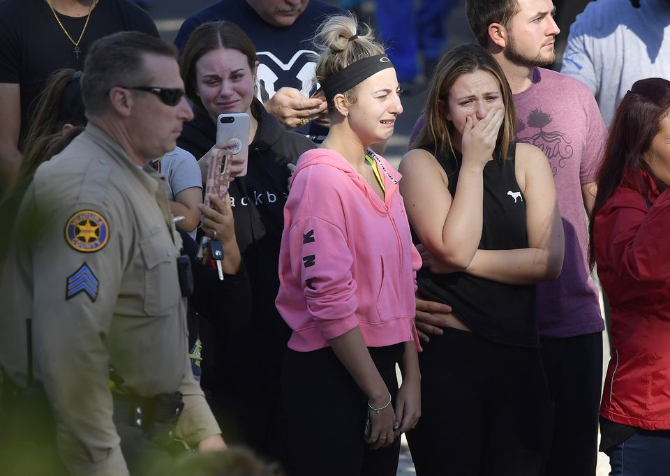 People cried as a law enforcement motorcade escorted the body of Ventura County Sheriff's Department Sgt. Ron Helus from the Los Robles Regional Medical Center in Thousand Oaks, Calif., on Thursday.