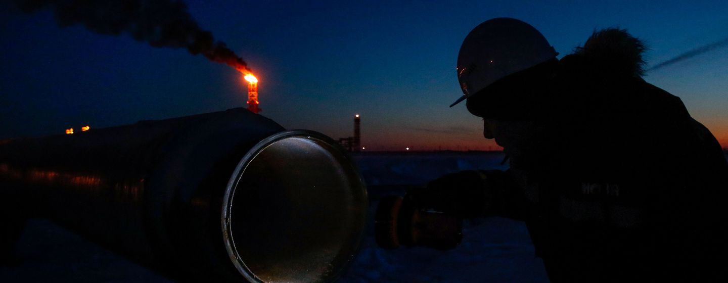 A worker inspected a pipe in the port of Sabetta on the Kara Sea.