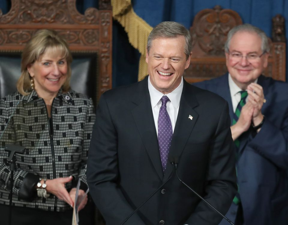 Governor Charlie Baker spoke at his inauguration with Mass State Senator President Karen Spilka on the left and Speaker of the House Robert DeLeo.