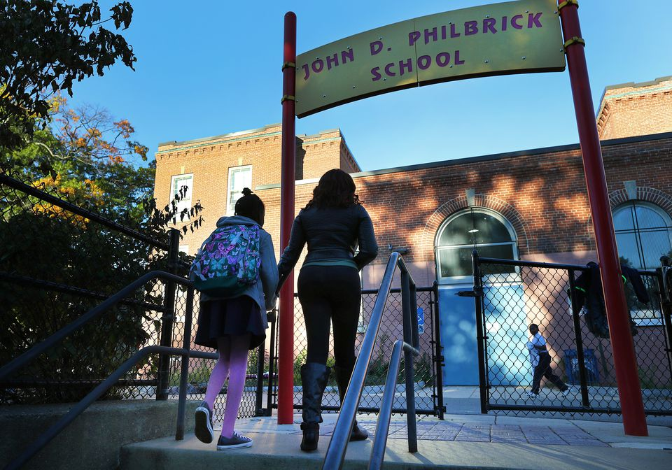 Janelle Smith arrived with daughter Alorah Miles, 9, at Philbrick Elementary in Roslindale, her school for now.