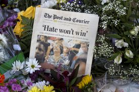 A newspaper was left as a sign of support at a makeshift memorial at Emanuel African Methodist Episcopal Church in Charleston on Saturday.