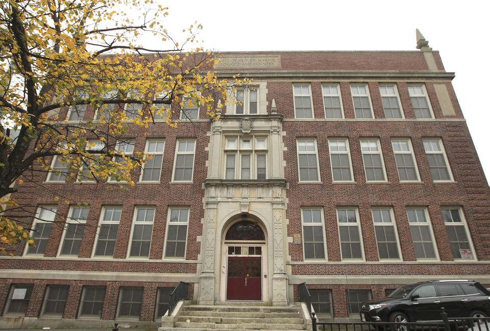 The former Gate of Heaven school building will be torn down to make way for parking.