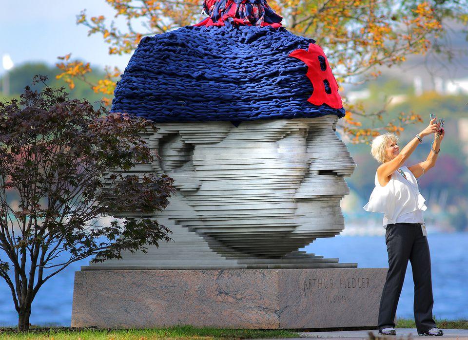 Nina Ficaro stopped for a selfie at the Arthur Fiedler Memorial.