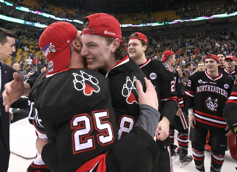 Northeastern Adam Gaudette hugged teammate Patrick Schule after the game.