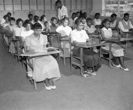 "Henrietta Hilton, front left, and her fellow students in their ninth grade classroom in Summerton, S.C., in 1954. The classroom was at the center of a controversy which led to one of four cases involving ""separate but equal"" facilities."