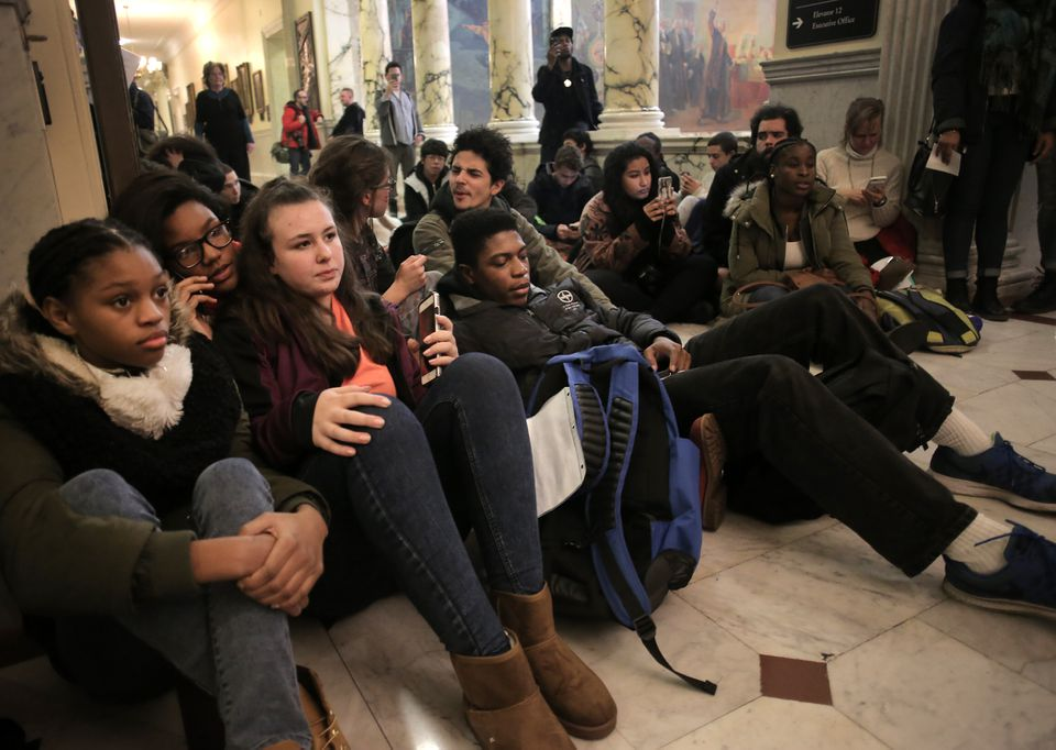 Protesters waited unsuccessfully to see Governor Charlie Baker outside his office.