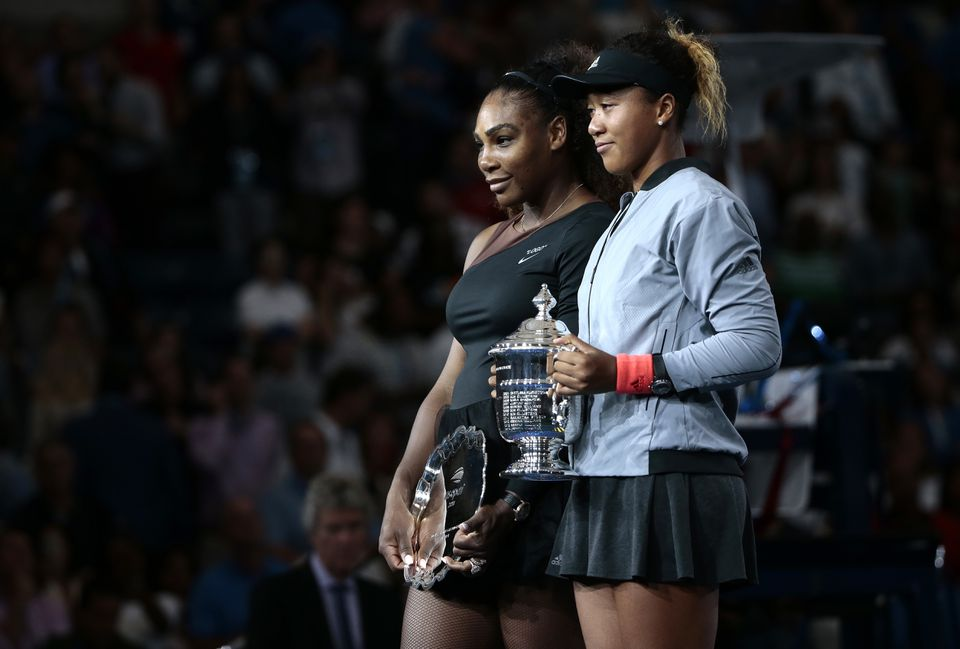 Serena Williams (eft) and Naomi Osaka posde for photos during the trophy ceremony after Osaka defeated Williams in the women's final of the U.S. Open tennis tournament.