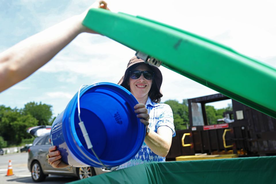 Robin Wechsler disposed of her family's food waste at the Wellesley Recycling and Disposal Facility.