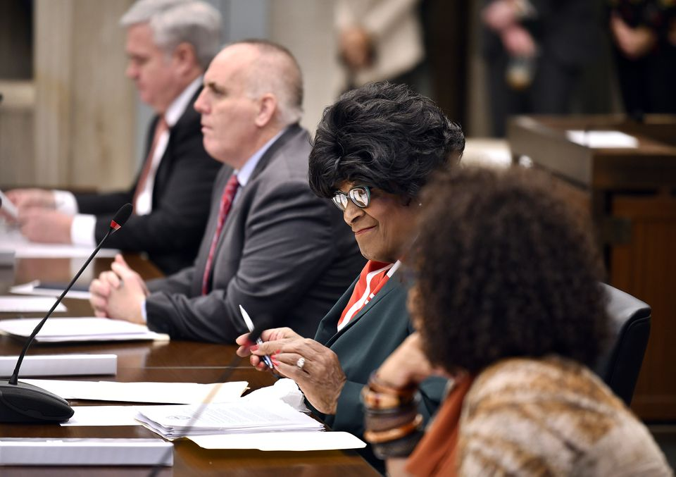 New City Councilor Althea Garrison smiled after taking her seat in the City Council chamber.