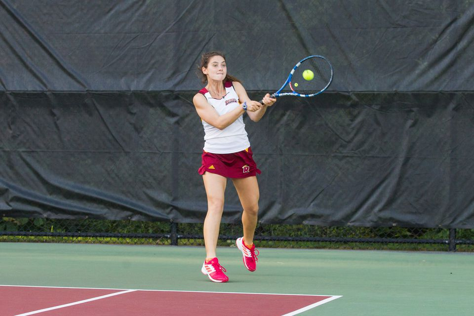 Canton's Carly Scanlon won the last singles match to give Regis women's tennis a 5-4 triumph over Simmons Oct. 1.