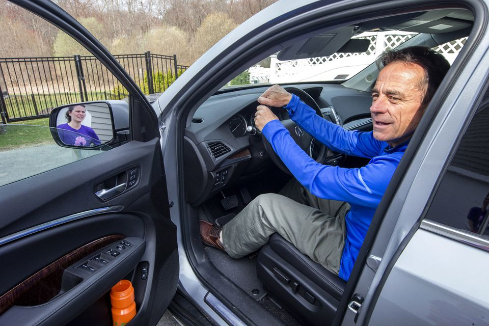 Boston Marathon race director Dave McGillivray leaves his North Andover home for a meeting with the mayor at City Hall.