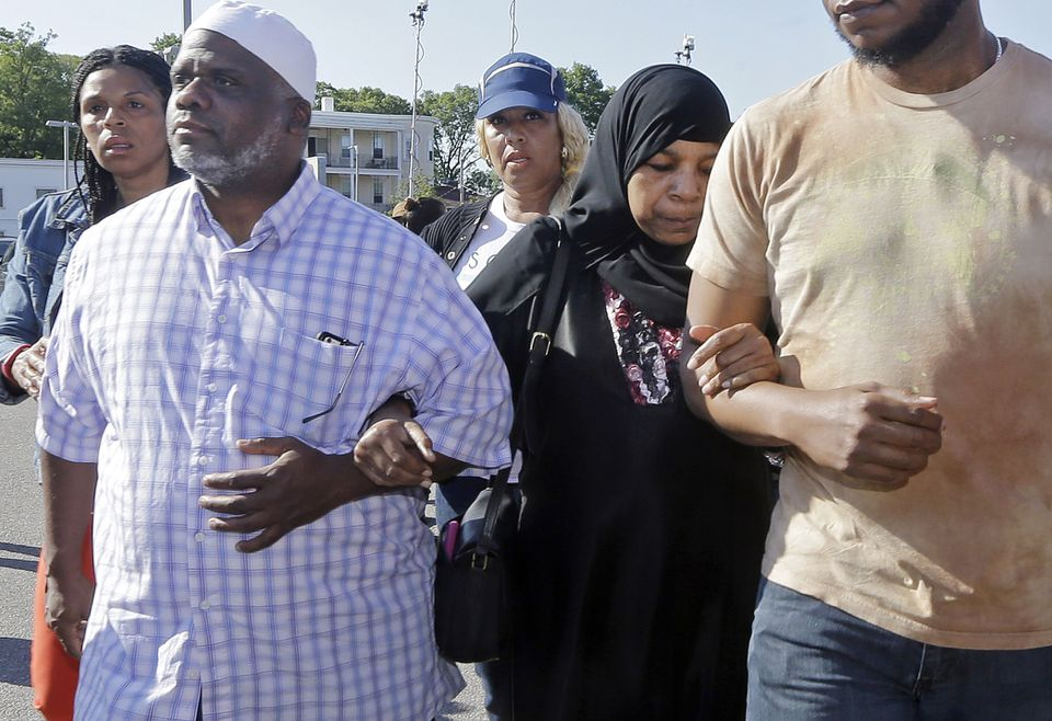 Rahimah Rahim, second from right, and Ibrahim Rahim, left, the mother and brother of shooting victim Usaama Rahim, walked away after a news conference on June 4, 2015.