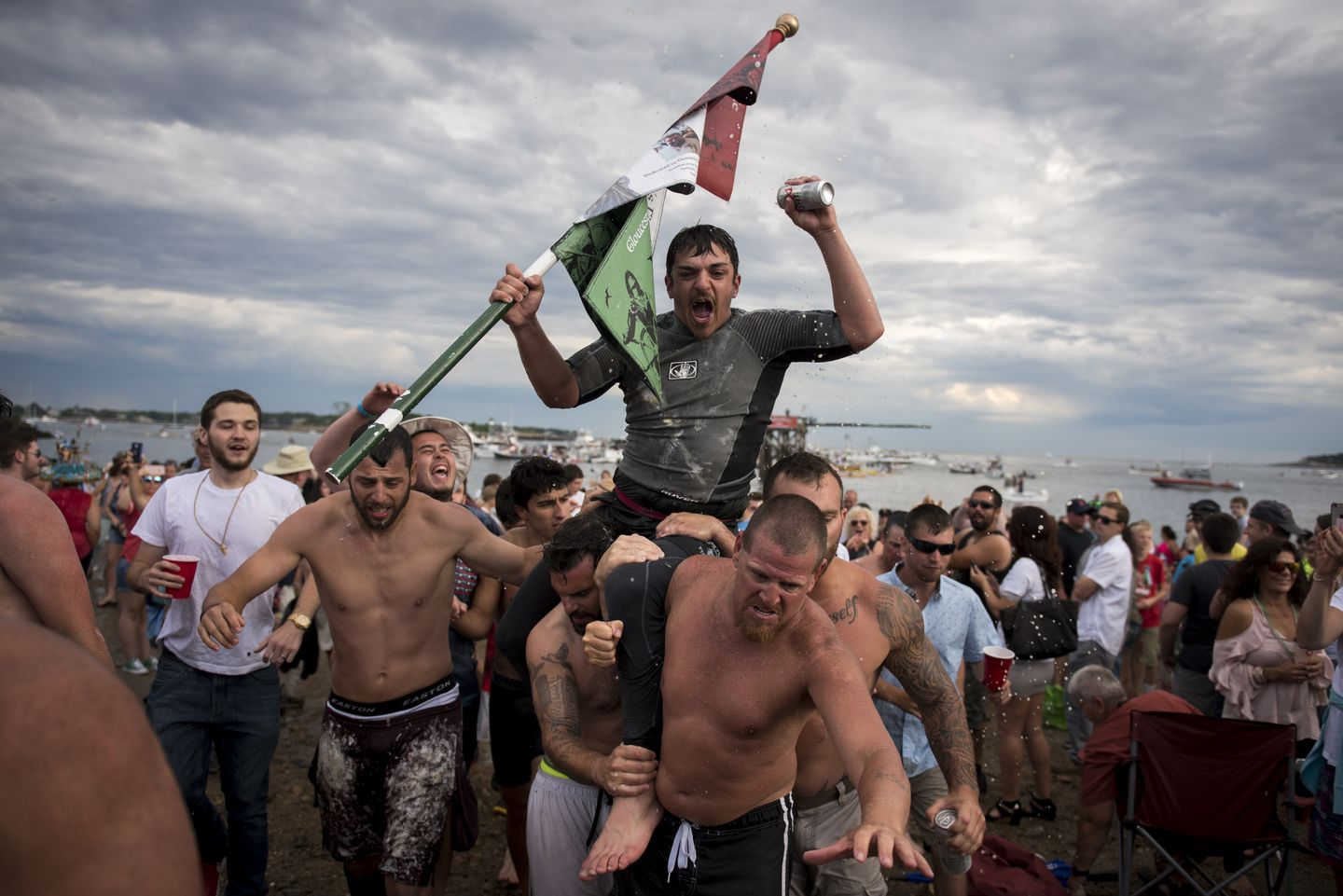 Gloucester residen Jack Wagner celebrates his Sunday greasy pole event win.