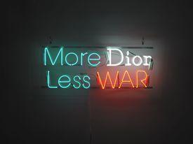 "A neon sign is part of Alejandro Diaz's ""RISD Business"" exhibit."