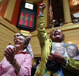 Lise Iwon (right) and Julie Smith celebrated after the gay marriage bill won final approval.