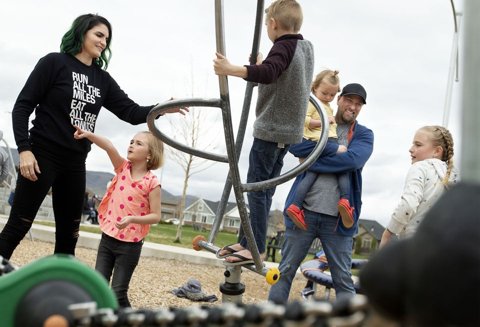 Laura Hall and her husband, John, played with their children, Max, 7, Olive, 9, Jayne, 5, and Violet, 3, in Saratoga Springs, Utah.