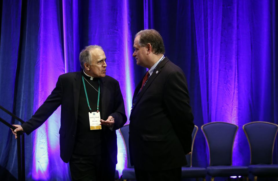 Cardinal Daniel DiNardo of the Archdiocese of Galveston-Houston, president of the United States Conference of Catholic Bishops, left, spoke with James Rogers, the conference's chief communications officer Tuesday in Baltimore.