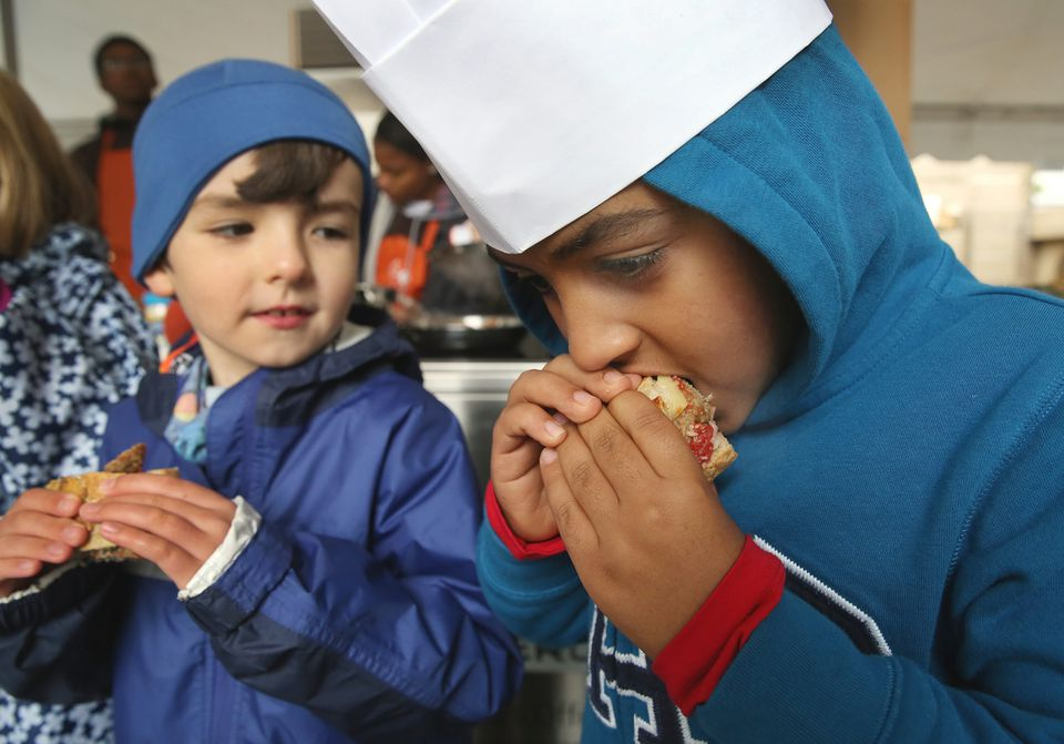 """Evan Hero, left, looked on as Mathious Girmay sampled a turkey meatball in a cook-off during """"Let's Talk About Food"""" festival in Copley Square."""