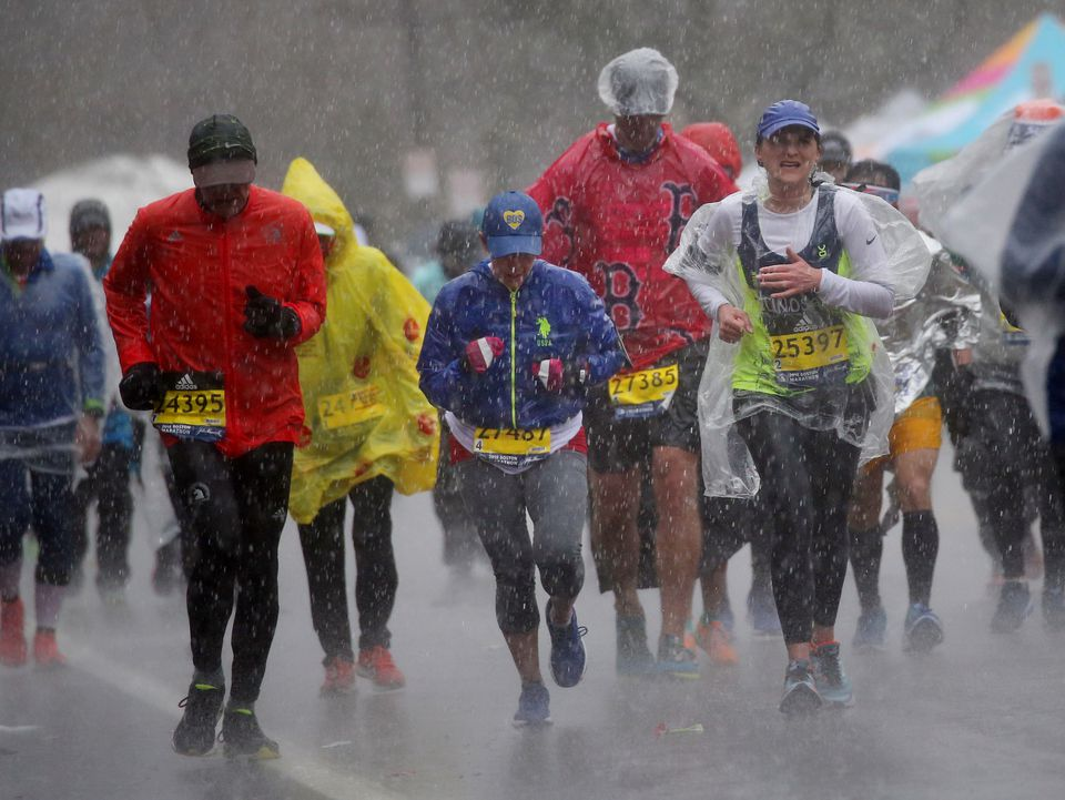 Runners had to deal with cold temperatures and rain throughout last year's Boston Marathon.