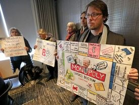 A group of protestors at the Thursday board meeting.