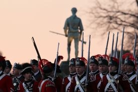 The British soldiers arrived on the Battle Green as the sun rose above the Minuteman statue, as the 238th anniversary of the Battle of Lexington began.
