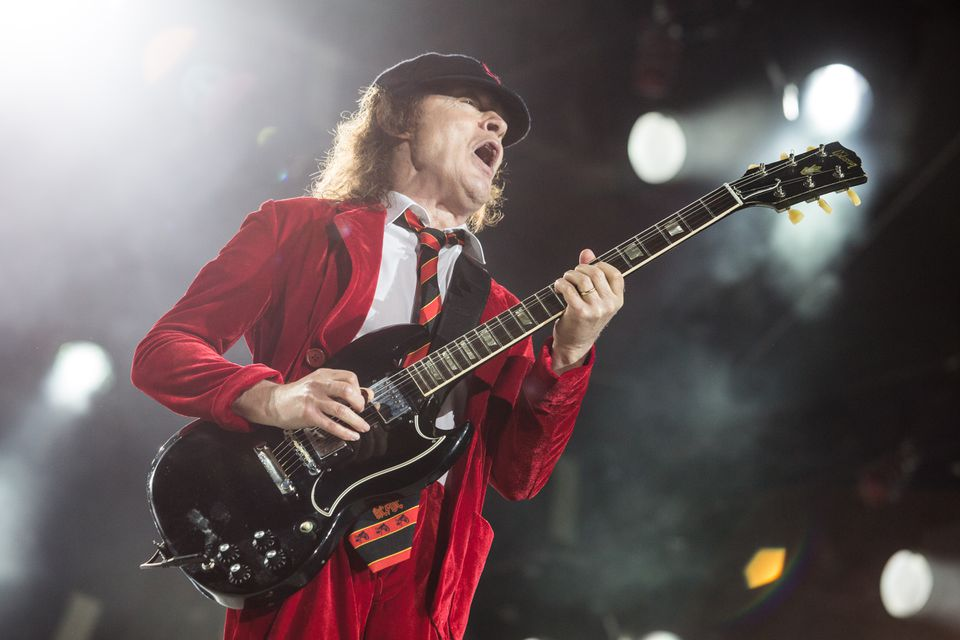Guitarist Angus Young performs with AC/DC in Foxborough Saturday.