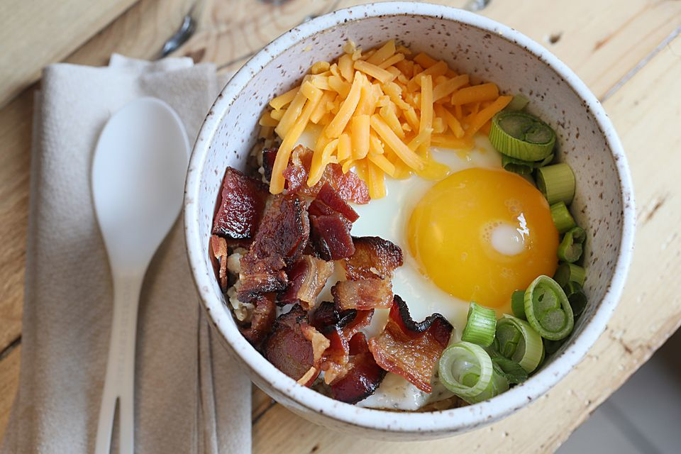 The savory bacon and egg oat bowl at Oat Shop in Somerville.