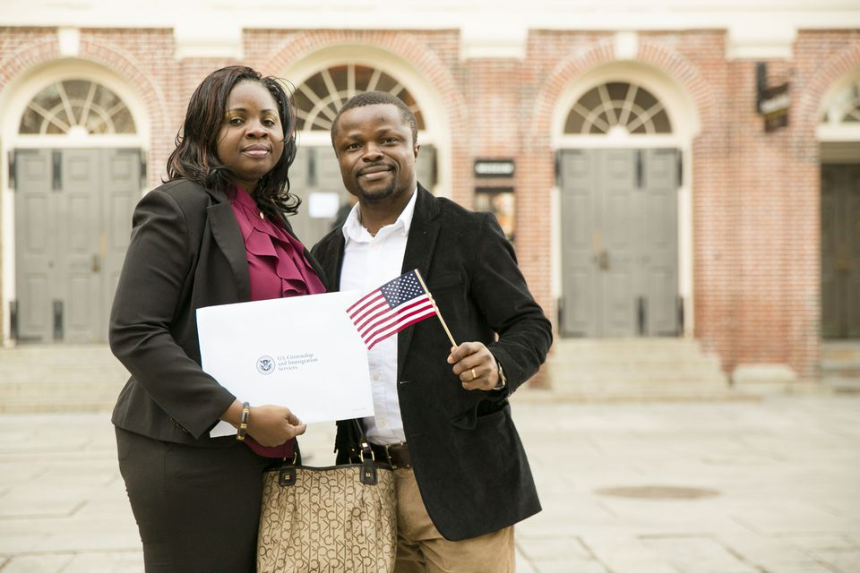 Uchenna and Ted Onuoha, from Nigeria, posed outside Faneuil Hall this month after becoming US citizens.