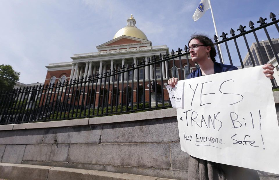 Asa Goodwillie of Watertown, Mass., who is transgender, protested outside the State House in Boston in June.