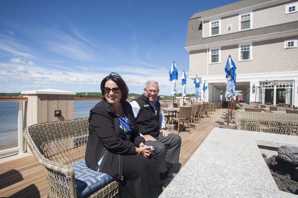 Owner Sheree Zizik with Lee Dellicker, chief executive and president of Windover Construction, sat on the deck of the Beauport Hotel in Gloucester.