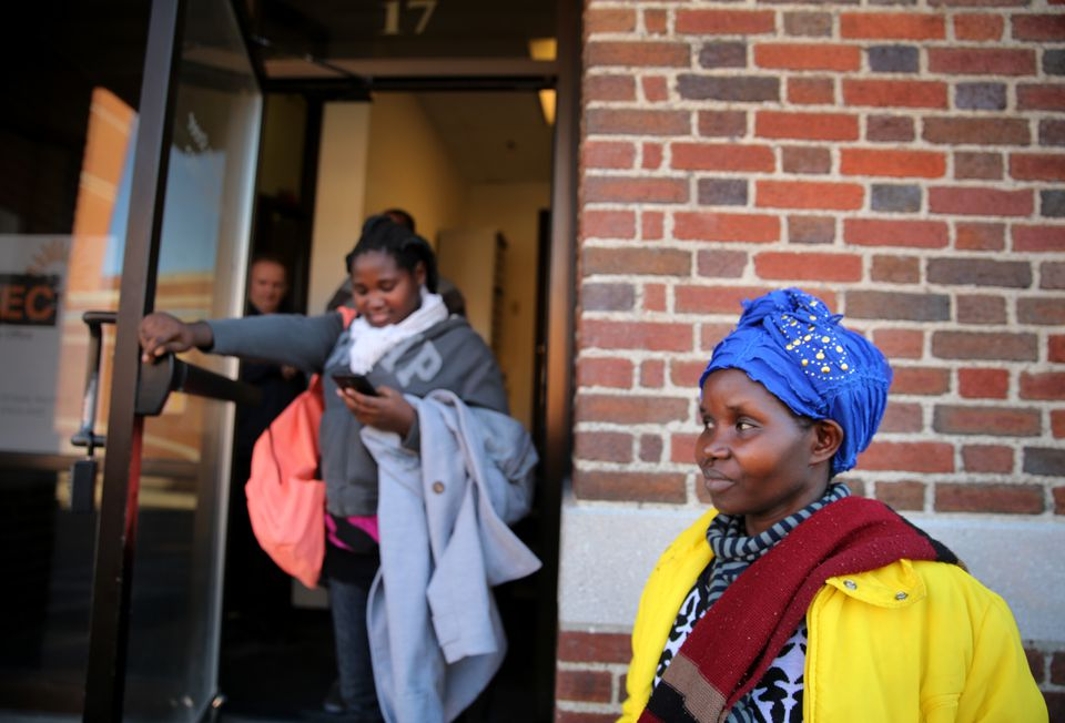 Vanisi Uzamukunda, right, and her daughter, Muhawenimana Nyirakabanza, 20, left the International Institute of New England after a meeting with their caseworker in Lowell.