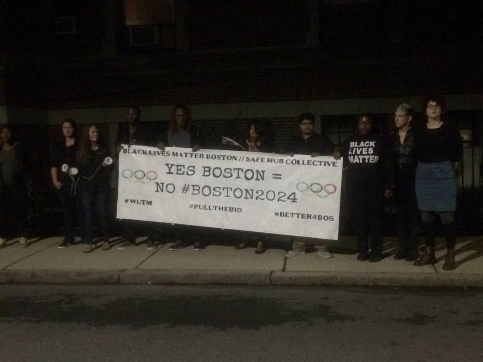 Protesters gathered Mayor Martin J. Walsh's house at 4 a.m. Monday morning.