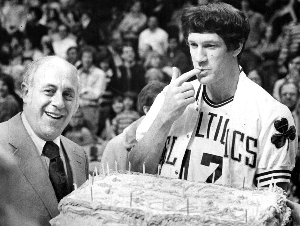 Red Auerbach and John Havlicek in April 1977.