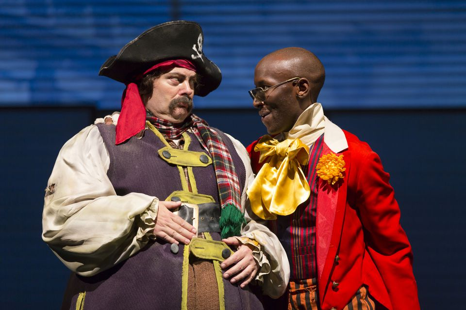 """Nick Offerman as Ignatius J. Reilly (left) and Phillip James Brannon as Burma Jones in the Huntington Theatre Company's """"A Confederacy of Dunces."""""""