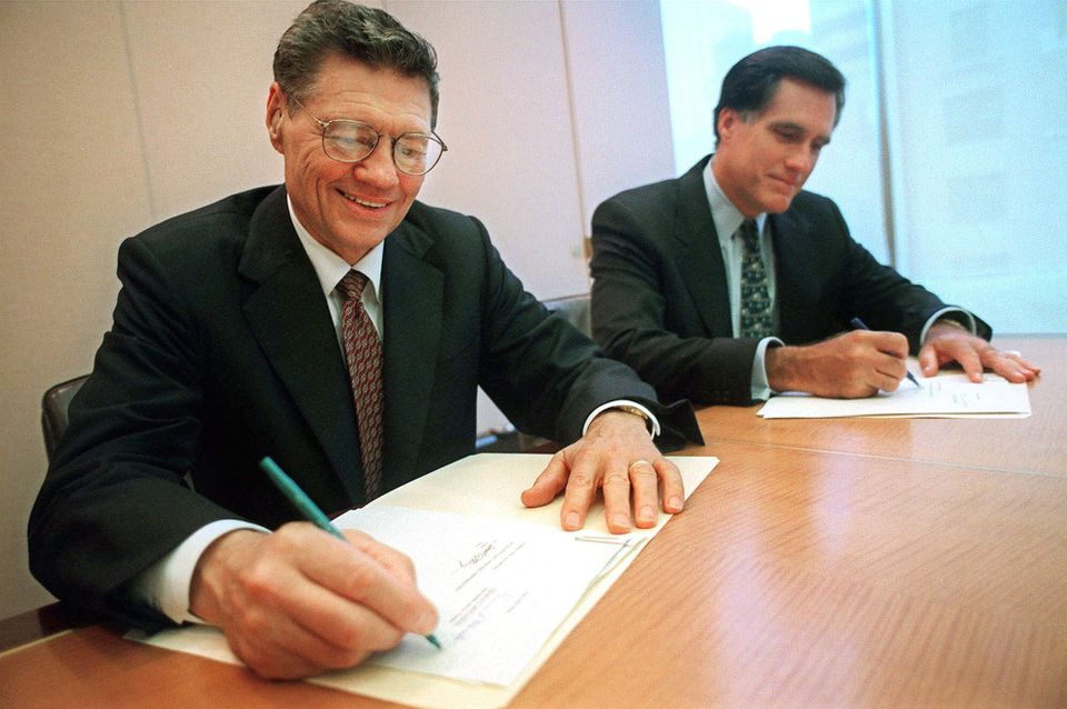 In 1998, Bain Capital, led by Mitt Romney, bought Domino's for $1.1 billion, investing $385 million in cash and borrowing the rest. Thomas Monaghan (on left) founded the company in 1960.
