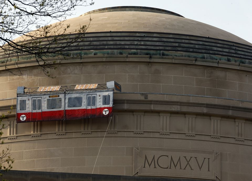 A replica of an MBTA Red Line car was placed on the dome in April 2009.