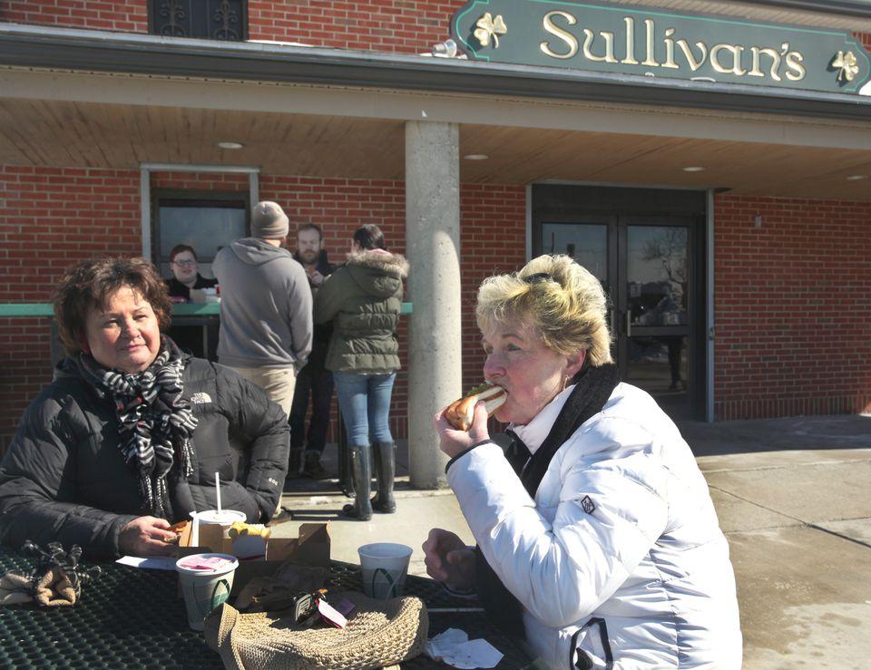 Ellen Shultz and Doris Rooney ate hot dogs at Sullivan's in South Boston in February 2015.