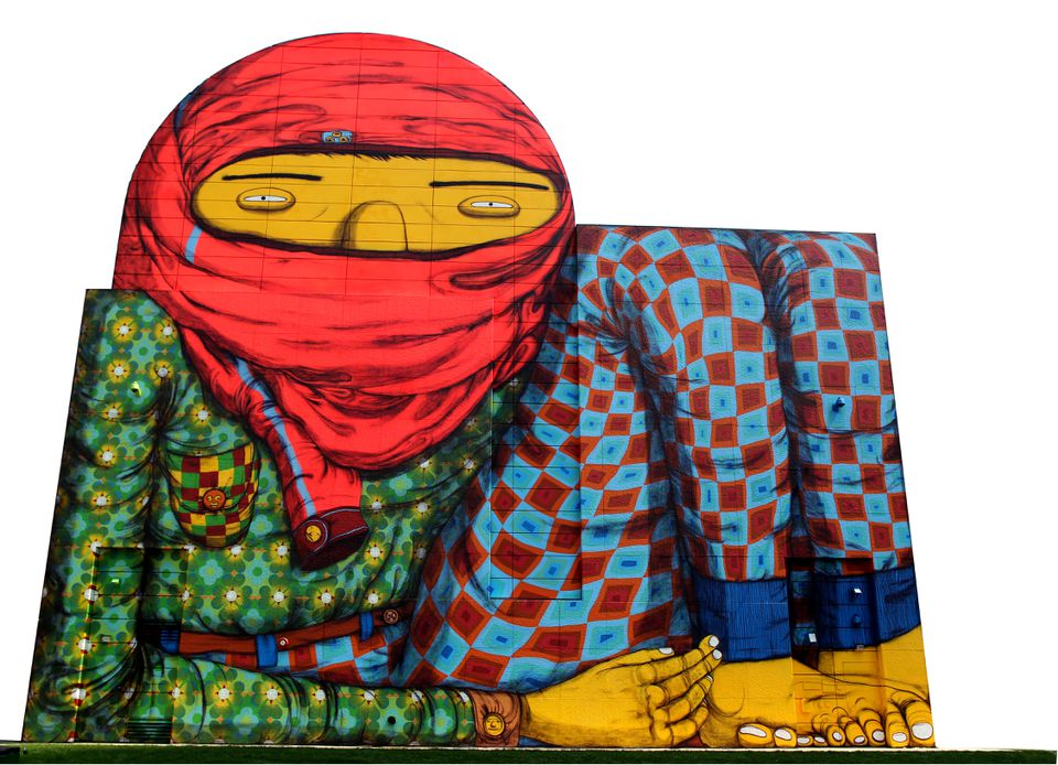 Os Gemeos's 70-by-70 feet mural of a boy in pajamas dominates Dewey Square.