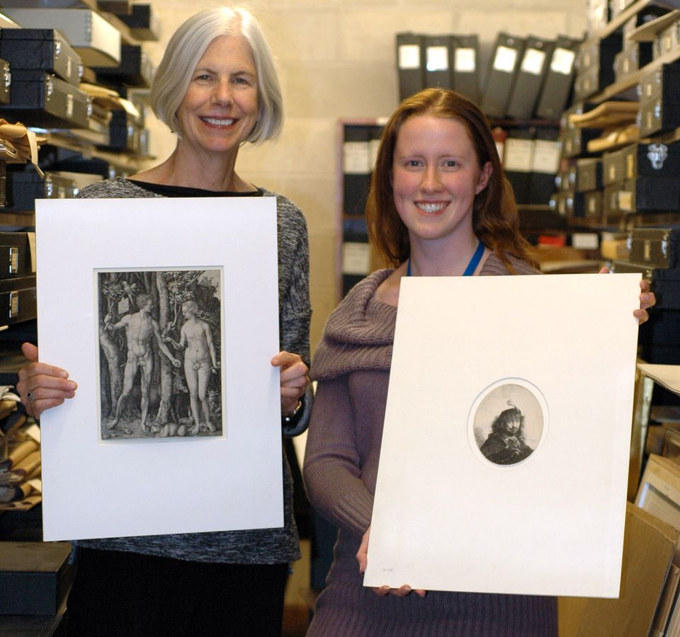 Lauren Schott (right), who found the prints, displayed the Rembrandt while president Amy Ryan held the Dürer.
