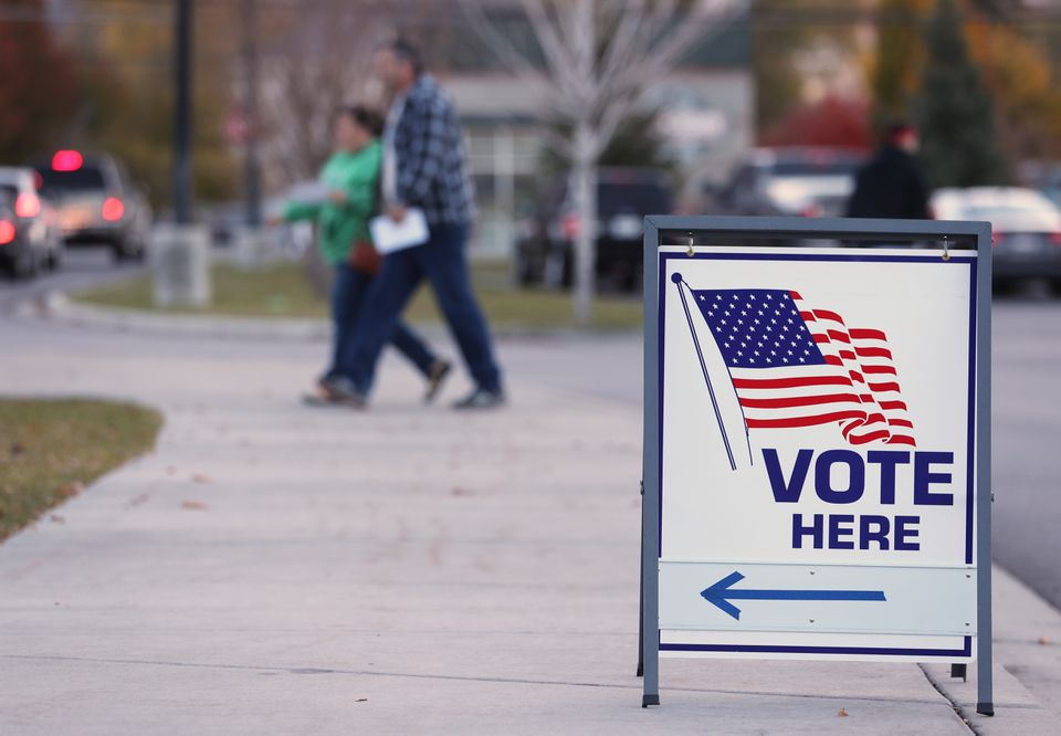 A couple walks into a polling center to vote in the midterm elections on Tuesday in Provo, Utah.
