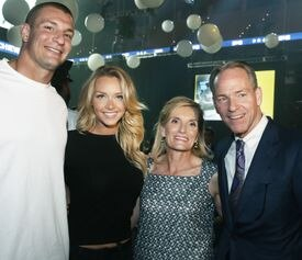 From left: Rob Gronkowski and Camille Kostek with Cyndy and John Fish.